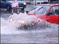 A car going through floods
