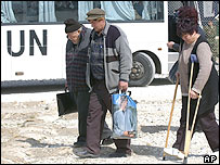Elderly Serbs leaving a Nato base