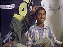 Ahmed is patted on the head by a local paramilitary