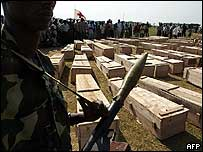 Soldier guarding coffins