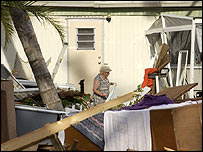 A lady amid her hurricane-hit home in Florida