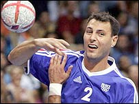 Jerome Fernandez of France tries to score a goal past Greece's Spyros Balomenos