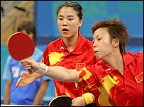 China's Guo Yue(right) and Niu Jianfeng in action in Athens
