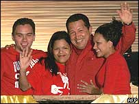 Venezuelan President Hugo Chavez and his children, from left to right, Hugo, Rosa Virginia, and Maria Gabriela celebrate in the Palace of Miraflores in Caracas on Monday