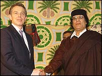 Tony Blair and Colonel Gaddafi shake hands