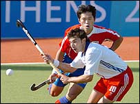 Yeo Woo Kong tries to get the ball past GB's Jimmy Wallis