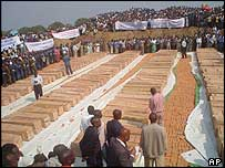 Coffins laid out at the mass funeral