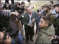 Reporters surround the boy Husam Abdu