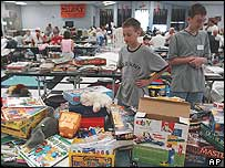 Brothers Tyler and Nathan Koskella look at games and toys at the Red Cross Shelter in Englewood, Florida