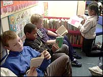 Children reading on a carpet in a classroom
