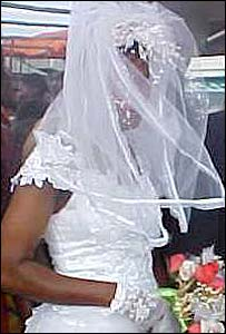 A woman in a wedding gown in Uganda