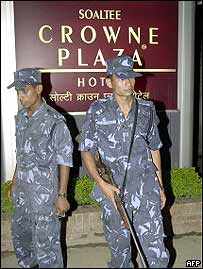 Soldiers stand guard outside Soaltee Crowne Plaza hotel