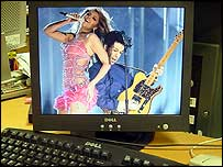 Computer monitor showing Beyonce and Prince