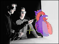 Surgeons examine virtual heart