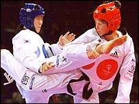 Lee Sun-Hee of South Korea takes on Norway's Trude Gundersen in Sydney