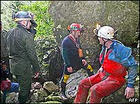 Mexican soldiers (left in green uniforms) confer with British speleologists near the cave where six Britons are trapped
