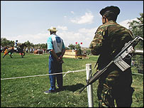 A security official at the three day eventing cross country competition