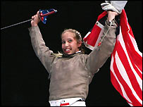 Mariel Zagunis waves the American flag