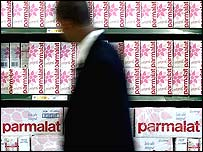 A shopper walks past Parmalat products