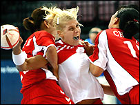 Rikke Hoerlykke Joergensen of Denmark tries to score a goal in front of Im Jeong Choi (L) and Pil Hee Moon of Korea