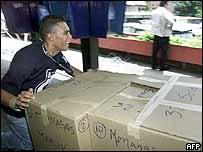 Venezuelan election worker wheels paper returns