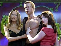 Madame Tussauds visitor (right) with figures of Brad Pitt and Jennifer Aniston