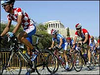Cyclists go past the Acropolis during the Olympic test event in August, 2003.
