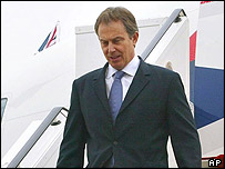 British Prime Minster walks off his plane at Tripoli airport