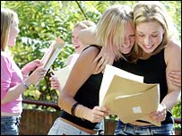 A-level students hugging on results day