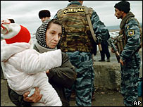 Woman with a child and Chechen policemen