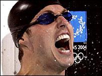 Dutchman Pieter van den Hoogenband celebrates his 100m victory