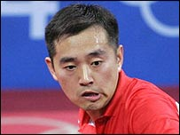 China's Linghui Kong is defeated in the men's table tennis doubles