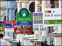 For sale signs in front of properties