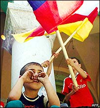 South Ossetian children wave Russian and South Ossetian flags