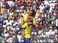 Brazil's Roger, top, embraces his teammate Ronaldo as they celebrate a goal against Haiti during a friendly match at the Sylvio Cator Stadium in Port-au-Prince, Haiti, on Wednesday