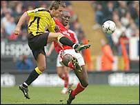 Villa midfielder Lee Hendrie (left) and Charlton striker Carlton Cole battle for possession