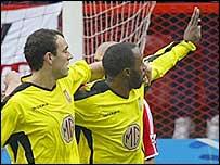 Aston Villa striker Darius Vassell (right) celebrates his equaliser with Gavin McCann