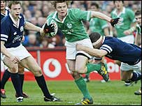 Ireland captain Brian O'Driscoll bursts through the Scotland line