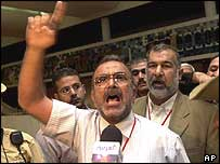 Hamed Abbud, a delegate from the southern city of Basra, protests at voting procedures on Wednesday
