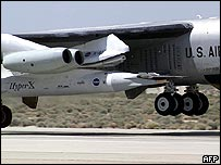 The tiny X-43, mounted on a rocket booster, is attached to the wing of a modified B-52 bomber