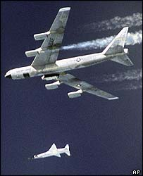 The X-43A jet, mounted on a Pegasus rocket booster, drops away from the B-52B bomber