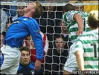 Henrik Larsson beats Michael Ball in the air to score