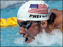 Michael Phelps competes in the 100m butterfly