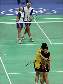 Gail Emms and Nathan Robertson watch their Chinese opponents celebrate victory