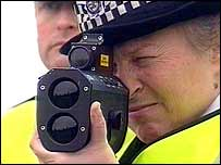 Policewoman with speed camera