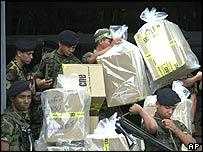 Venezuelan soldiers unload boxes of ballots