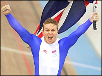 Chris Hoy celebrates winning the one kilometre time trial in Athens