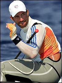 Ben Ainslie salutes another victory in the Finn class