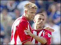 Kevin Phillips accepts the congratulations of James Beattie