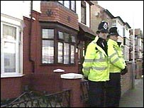 Police outside one of raided houses
